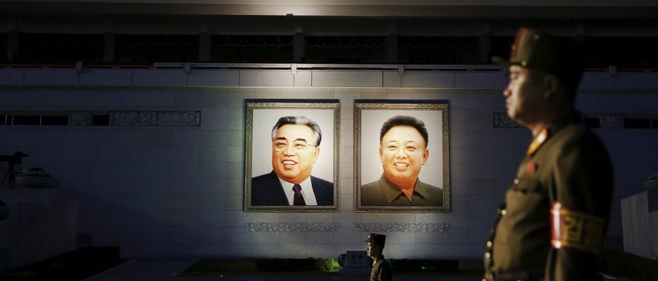 Soldiers guard a grand stand decorated with portraits of North Korea's founder Kim Il-sung and former leader Kim Jong-il after the parade celebrating the 70th anniversary of the founding of the ruling Workers' Party of Korea, in Pyongyang