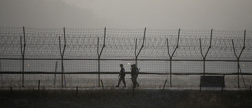 South Korean soldiers patrol along a barbed-wire fence at a guard post near the demilitarized zone separating the two Koreas in Paju