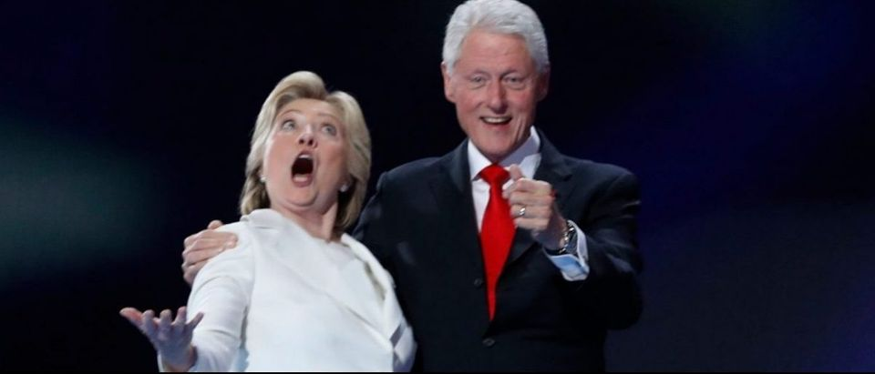 Democratic presidential nominee Hillary Clinton and her husband former president Bill Clinton react to the balloon drop after she accepted the nomination on the fourth and final night at the Democratic National Convention in Philadelphia, Pennsylvania, U.S. July 28, 2016