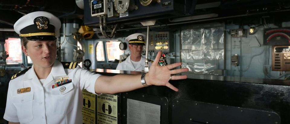 A U.S. navy officer gestures on the U.S.S. Benfold, a guided-missile destroyer during a scheduled visit to the Chinese port city of Qingdao
