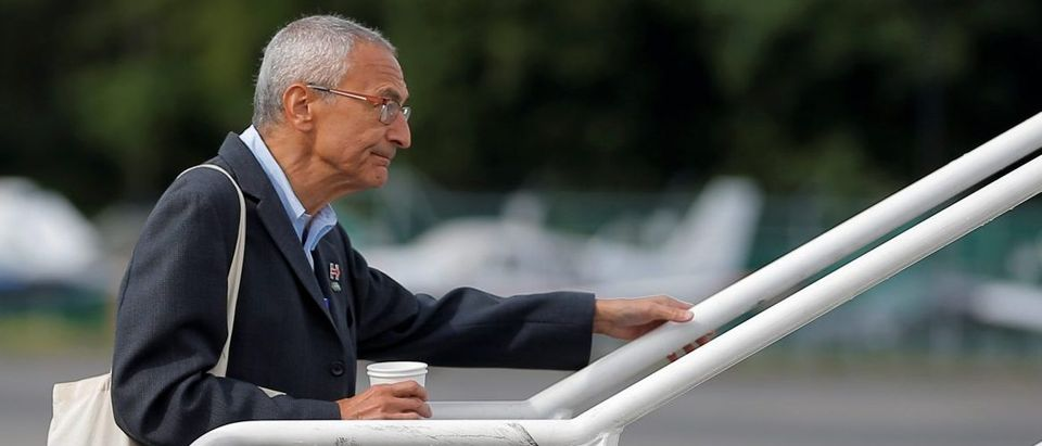 John Podesta, campaign chairman for U.S. Democratic presidential candidate Hillary Clinton, boards her campaign plane in White Plains