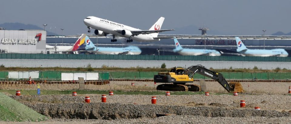 A Japan Airlines airplane takes off during a groundbreaking ceremony for a second terminal of the Incheon Airport in Incheon