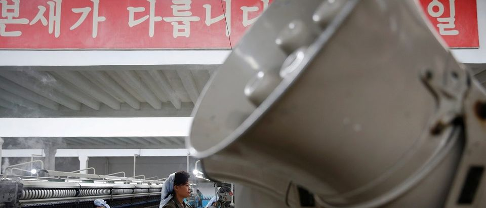A loudspeaker blasting propaganda music is placed inside one of halls of the Kim Jong Suk Pyongyang textile mill during a government organised visit for foreign reporters in Pyongyang
