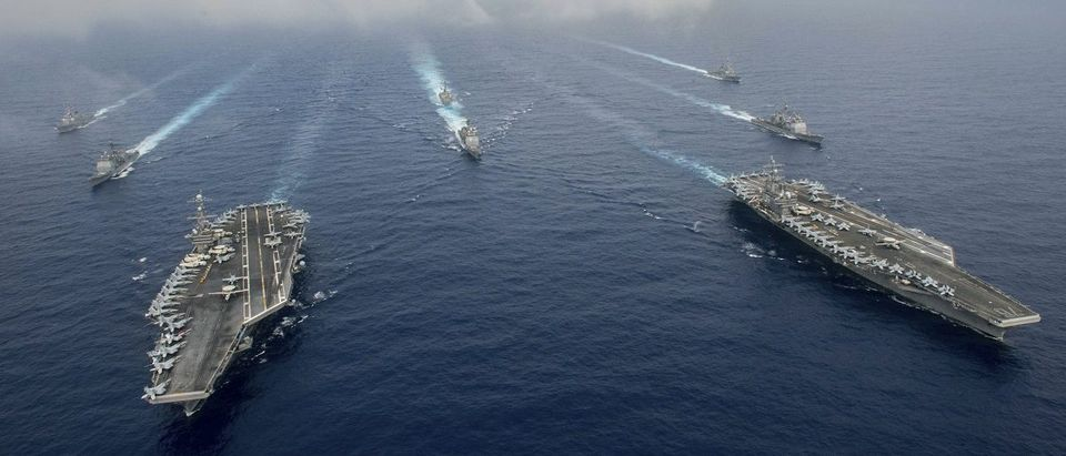 The Nimitz-class aircraft carriers USS John C. Stennis (CVN 74) and USS Ronald Reagan (CVN 76) in the Philippine Sea