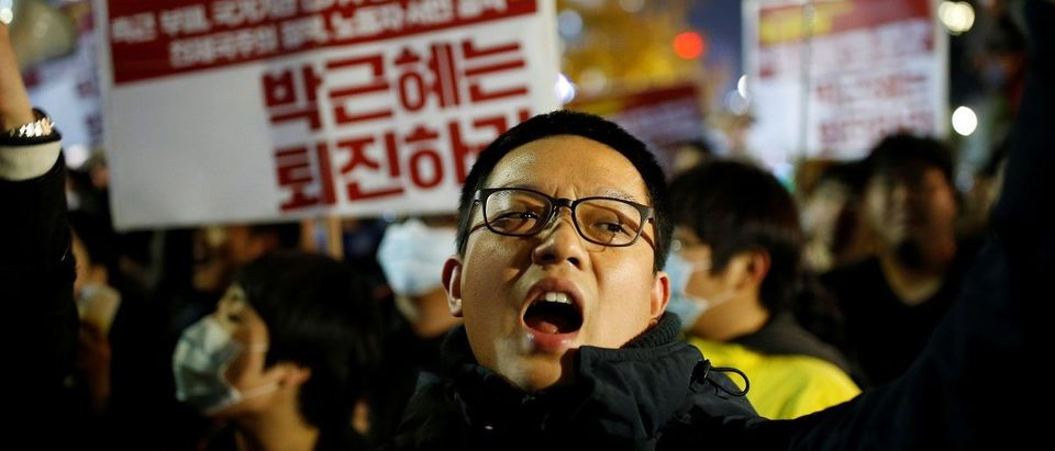 Protester chants slogans during a protest denouncing South Korean President Park Geun-hye over a recent influence-peddling scandal in central Seoul