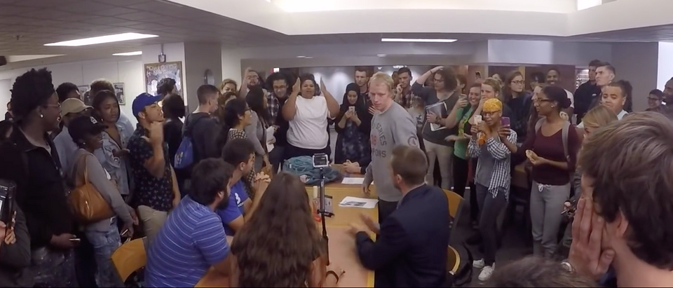Protesters surround their conservative classmates (YAF Screengrab)