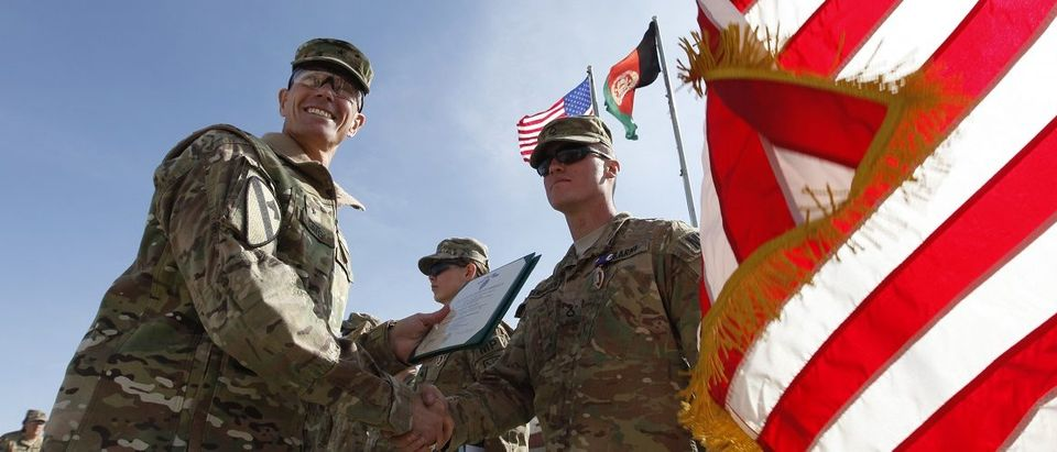 PFC. Dennington receives his Purple Heart from Brigadier General Davis during a ceremony in FOB Airborne in Wardak province