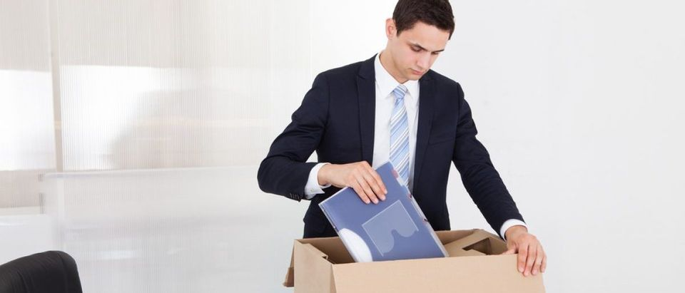 Fired businessman packing files [Shutterstock - Andrey_Popov]