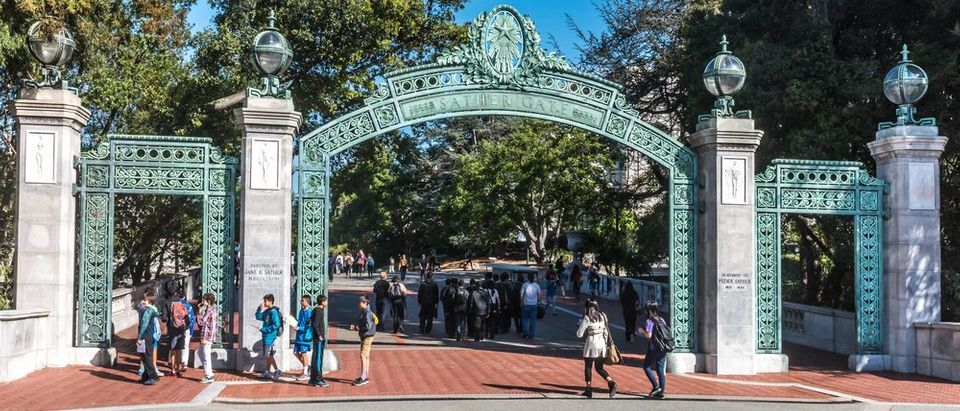 Berkeley, California - March 16, 2016: Students at the University of California pass through Sather Gate, a landmark built in 1910, connects Sproul Plaza to the center of the college campus