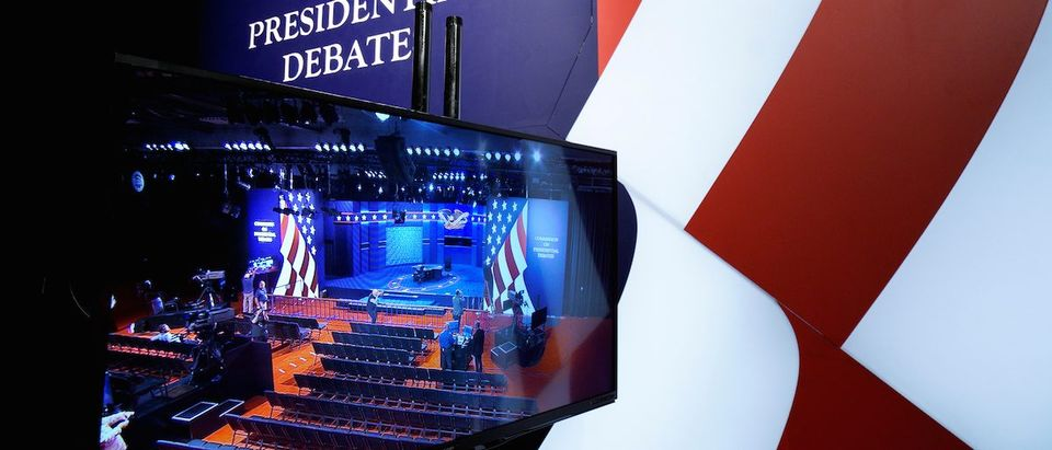The stage for the vice presidential debate is seen on a television monitor at Longwood University in Farmville, Virginia October 3, 2016