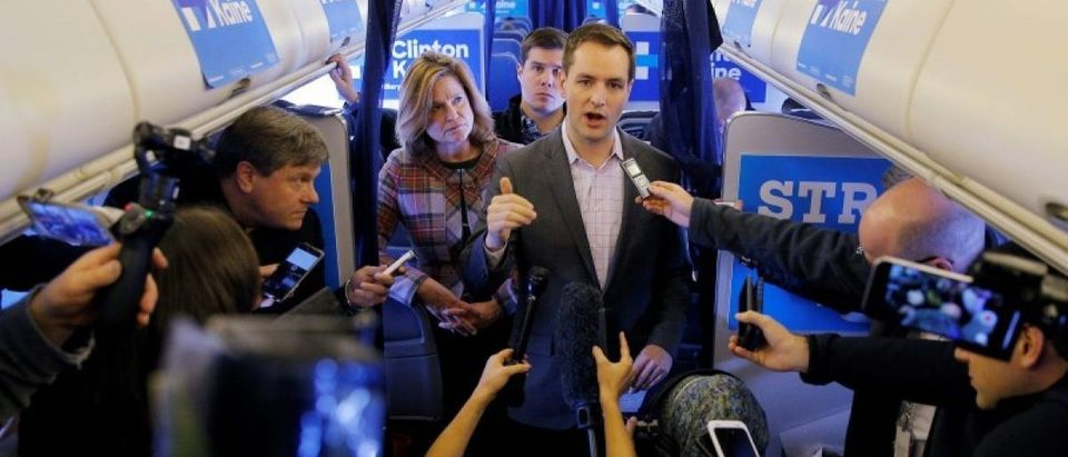 Robby Mook, Campaign Manager for U.S. Democratic presidential nominee Hillary Clinton, and Communications Director Jen Palmieri talk to reporters onboard the campaign plane enroute to Cedar Rapids