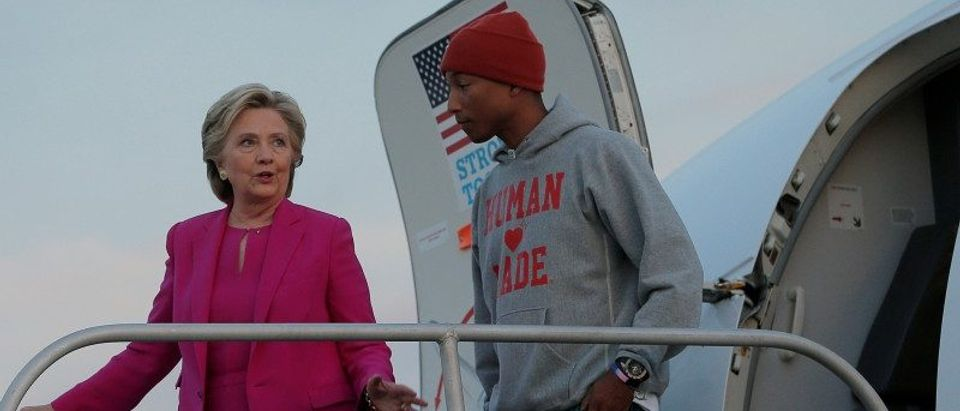 U.S. Democratic presidential nominee Hillary Clinton is joined by musician Pharrell Williams at her campaign plane in Morrisville