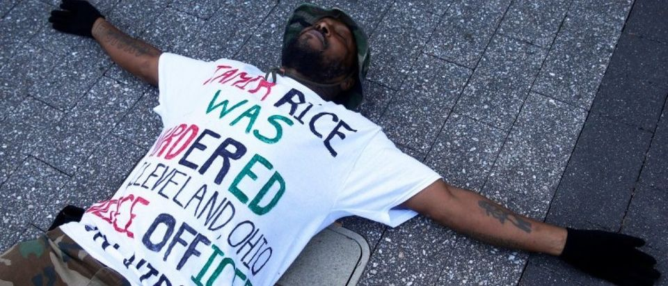 Stevedore Crawford Jr. lies on the ground during a Black Lives Matter rally in Columbus, Ohio U.S., October 28, 2016. REUTERS/Shannon Stapleton