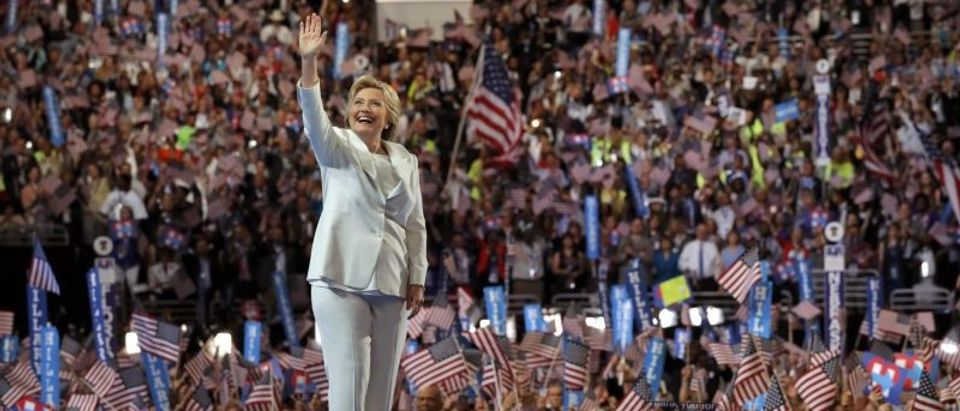 Democratic U.S. presidential nominee Hillary Clinton waves as she arrives to accept the nomination on the fourth and final night at the Democratic National Convention in Philadelphia
