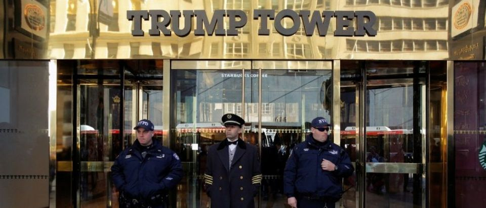 Members of the New York Police Department's Counterterrorism Bureau stand with a doorman outside U.S. Republican presidential nominee Donald Trump's Trump Tower ahead of the U.S. presidential election in Manhattan, New York