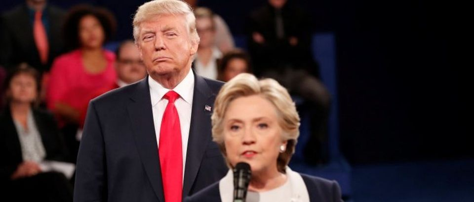 Republican U.S. presidential nominee Donald Trump listens as Democratic nominee Hillary Clinton answers a question from the audience during their presidential town hall debate at Washington University in St. Louis, Missouri, U.S., October 9, 2016. REUTERS/Rick Wilking /File Photo