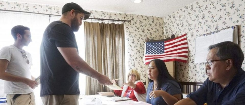 Voters check in to cast their ballots during voting in the 2016 presidential election in San Diego