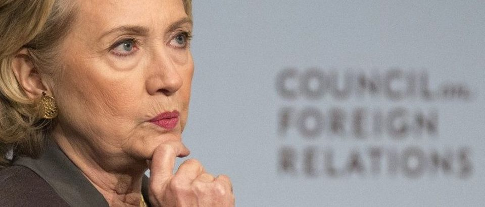 Former U.S. Secretary of State Hillary Clinton reacts while speaking at the Council on Foreign Relations with CFR President Richard Haass in Manhattan, New York
