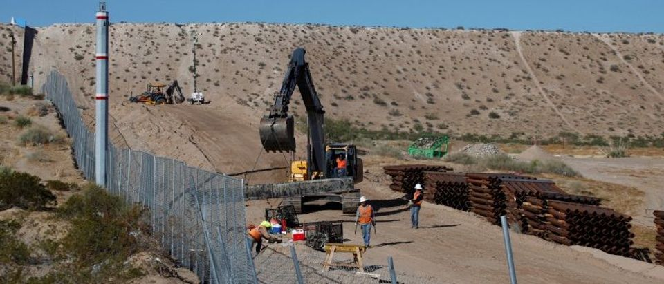 U.S. workers build a section of the U.S.-Mexico border wall at Sunland Park, U.S. opposite the Mexican border city of Ciudad Juarez