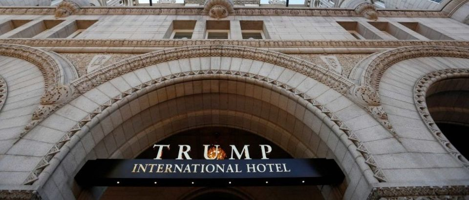 Flags fly above the entrance to the new Trump International Hotel on its opening day in Washington