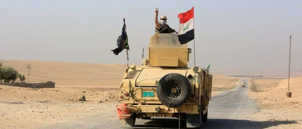 Iraqi soldiers drive into to Shahrezad village east of Mosul