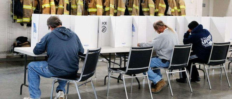 Voters fill out their ballots on election day for the U.S. presidential election at Elevation Fire Station in Benson