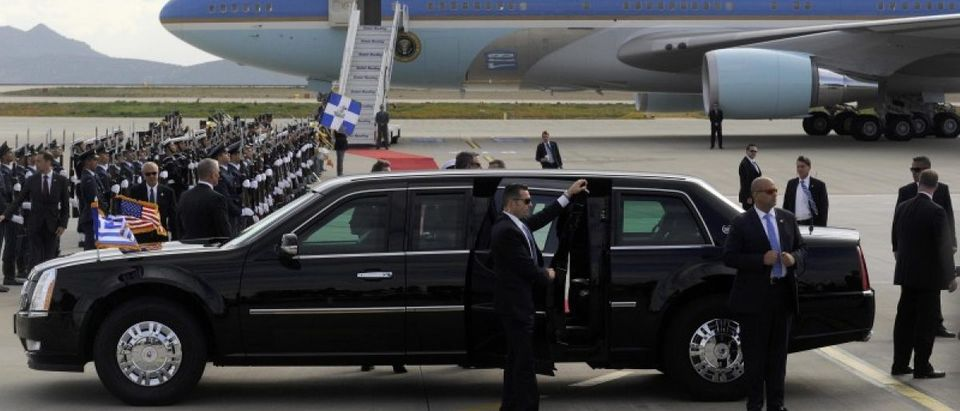 Secret Service agents stand beside the U.S President Obama's limousine following his arrival at the Eleftherios Venizelos International airport in Athens