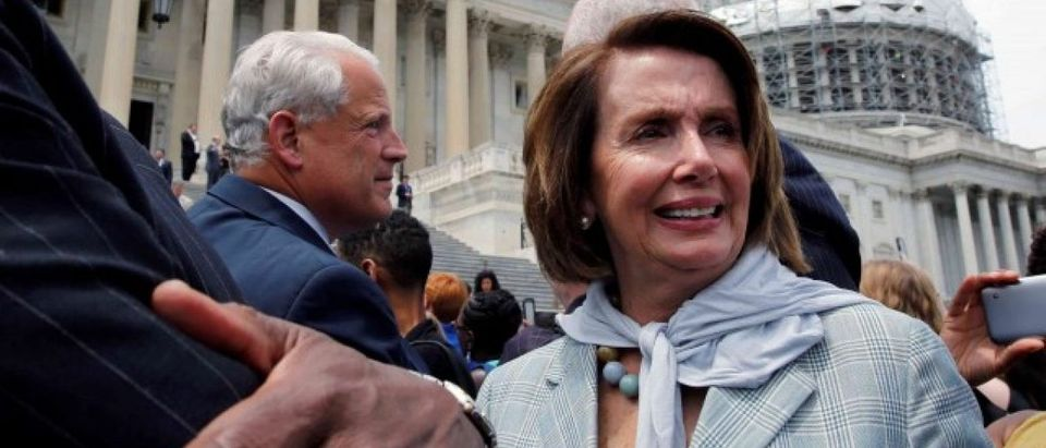 U.S. House Minority Leader Nancy Pelosi (D-CA) and Rep. James Clyburn (D-SC) walk out with House Democrats on Capitol Hill in Washington