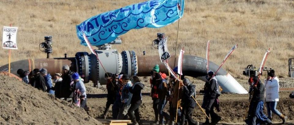 Protesters march along the pipeline route during a protest against the Dakota Access pipeline near the Standing Rock Indian Reservation in St. Anthony, North Dakota