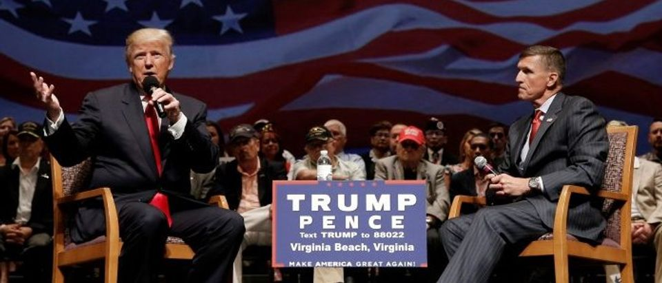 Republican presidential nominee Donald Trump speaks along side retired U.S. Army Lieutenant General Michael Flynn during a campaign town hall meeting in Virginia Beach, Virginia