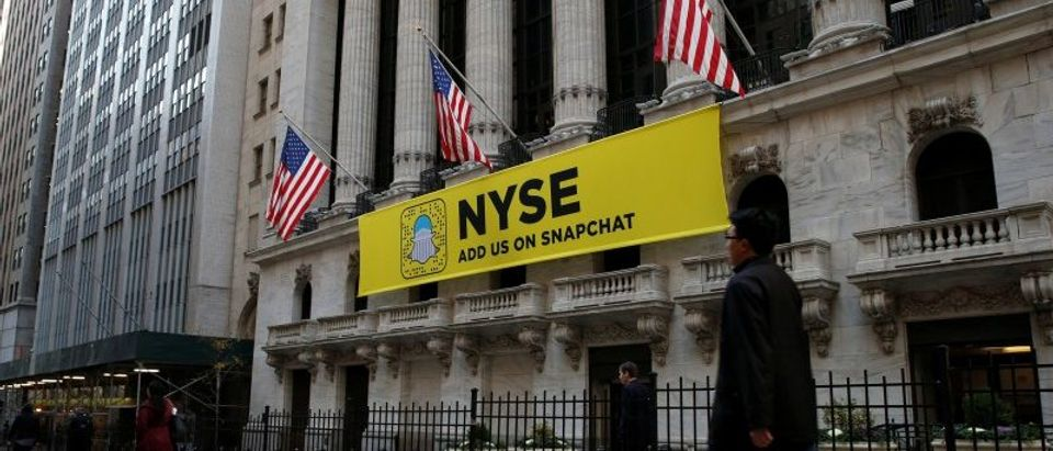 The Snapchat logo is seen on a banner outside the NYSE