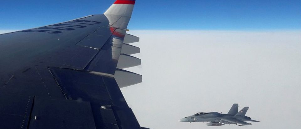 View from Russian Il-96 plane shows Swiss Air Force F/A-18 fighter jet in airspace above Switzerland