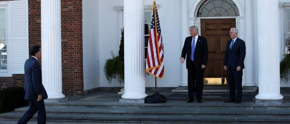 U.S. President-elect Donald Trump and Vice President-elect Mike Pence greet former Massachusetts Governor Mitt Romney as he arrives for their meeting at the the main clubhouse at Trump National Golf Club in Bedminster,