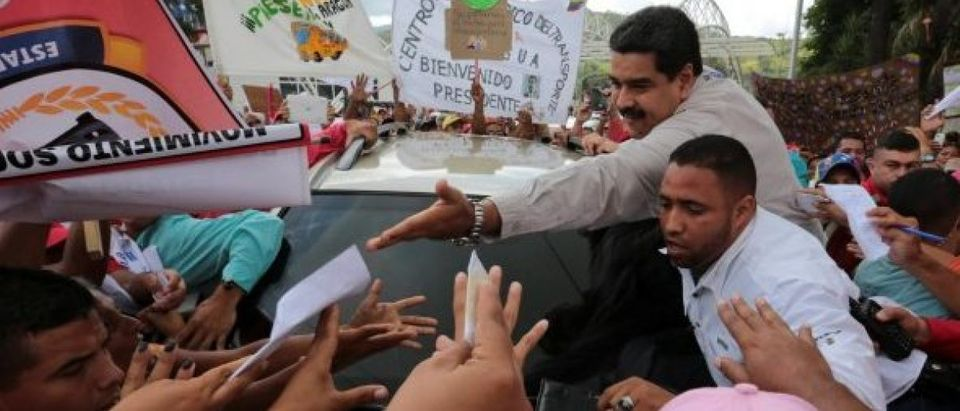 "Venezuela's President Nicolas Maduro greets supporters as he arrives for his weekly broadcast ""En contacto con Maduro"" (In contact with Maduro) in La Victoria"