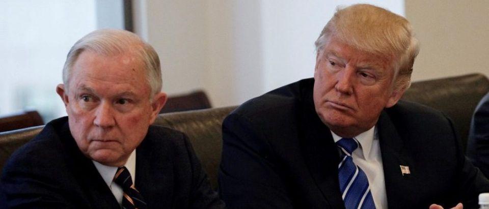 Donald Trump sits with U.S. Senator Jeff Sessions: REUTERS/Mike Segar