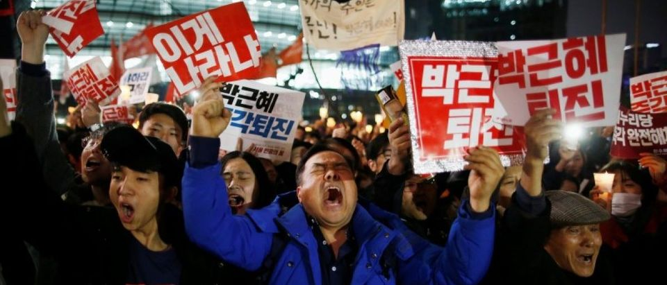 People chant slogans as they march toward the Presidential Blue House during a protest calling South Korean President Park Geun-hye to step down in Seoul