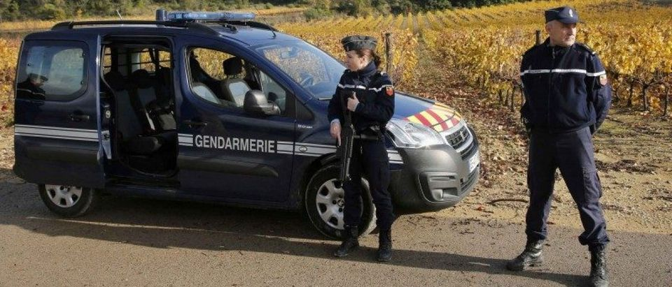 French gendarmes stand guard near a retirement home in Montferrier-sur-Lez, near Montpellier