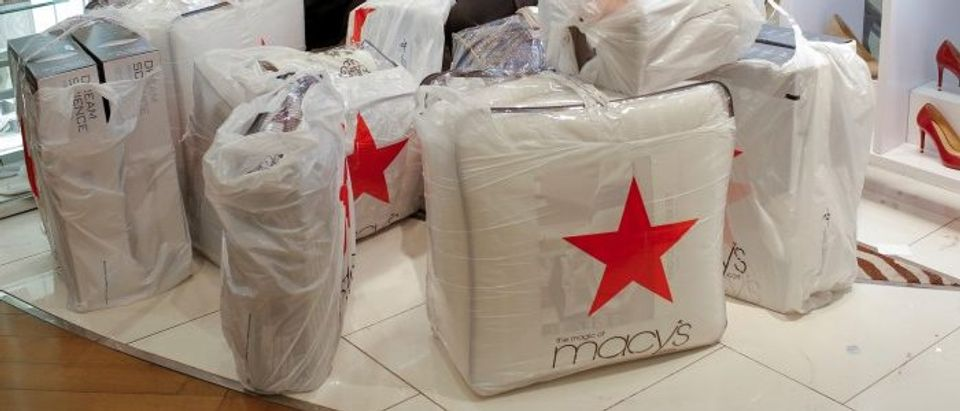 People wait with purchases at Macy's Herald Square during the Black Friday sales in Manhattan, New York, U.S.