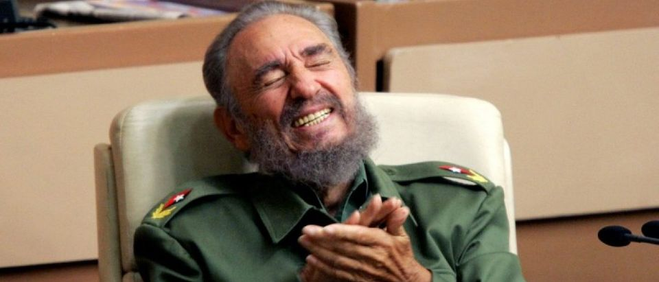 File photo of then Cuban President Fidel Castro laughing during the year-end session of the Cuban parliament in Havana