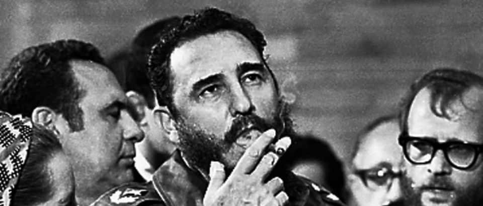 File photo of then Cuban Prime Minister Fidel Castro smoking a cigar during interviews with the press during a visit of U.S. Senator Charles McGovern, in Havana