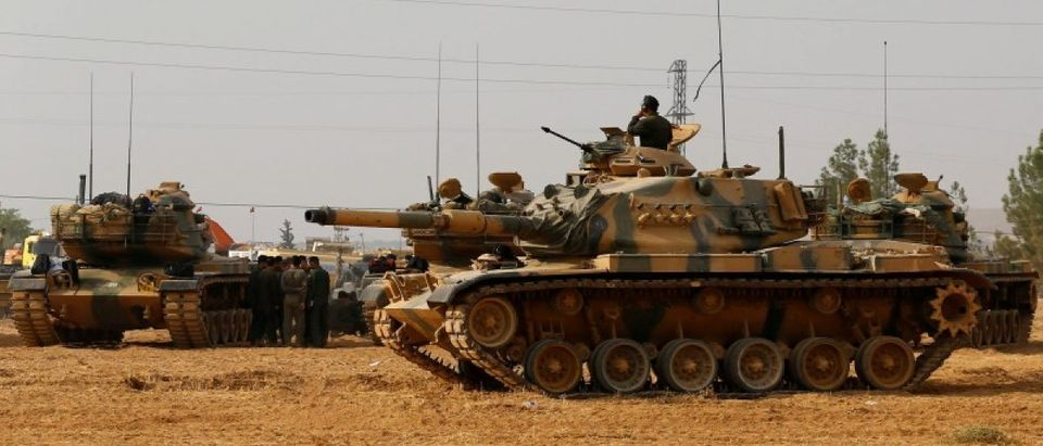 Turkish army tanks and military personal are stationed in Karkamis on the Turkish-Syrian border in the southeastern Gaziantep province