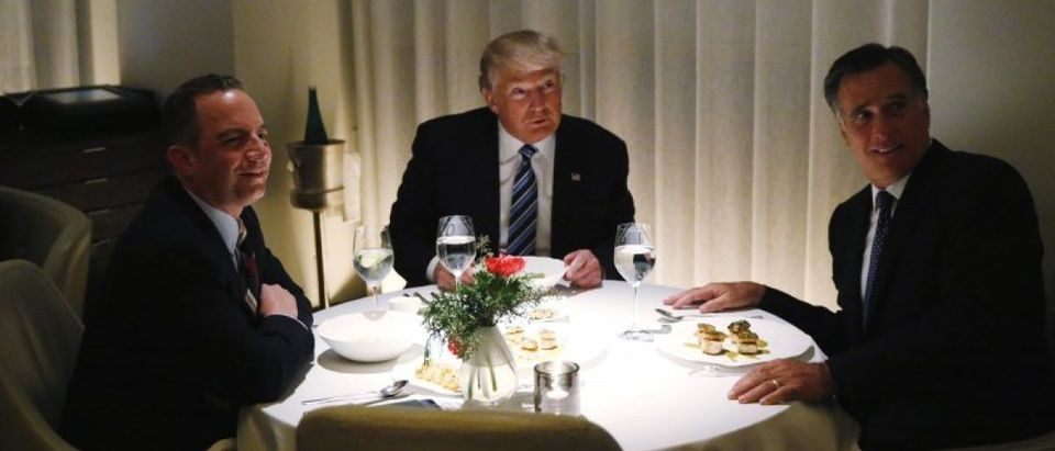 U.S. President-elect Donald Trump sits at a table for dinner with former Massachusetts Governor Mitt Romney (R) and his choice for White House Chief of Staff Reince Priebus (L) at Jean-Georges at the Trump International Hotel & Tower in New York, U.S., November 29, 2016. REUTERS/Lucas Jackson