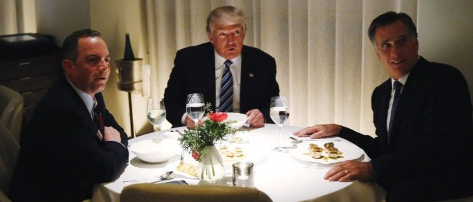 U.S. President-elect Trump sits at a table for dinner with former Massachusetts Governor Romney and his choice for White House Chief of Staff Priebus at Jean-Georges at the Trump International Hotel & Tower in New York