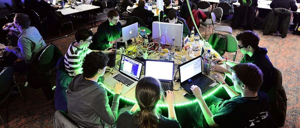 HAMBURG, GERMANY - DECEMBER 28: Participants work at their laptops at the annual Chaos Computer Club (CCC) computer hackers' congress, called 29C3. (Photo by Patrick Lux/Getty Images)