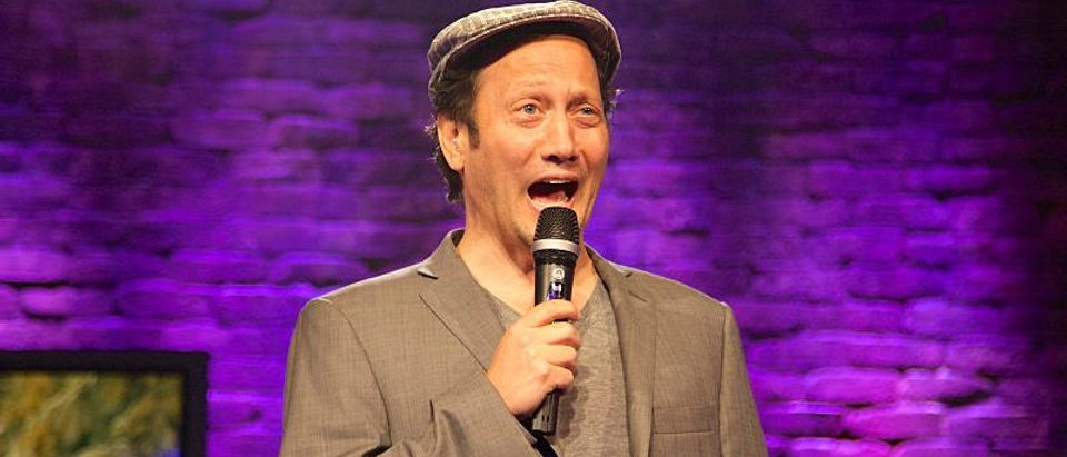 "Rob Schneider performs onstage at the NUVOtv and Levity Entertainment October 1st ""Stand Up & Deliver Cabo Relief"" event benefiting Hurricane-Devastated Cabo San Lucas held at the Irvine Improv on October 1, 2014 in Irvine, California. (Photo by Rochelle Brodin/Getty Images for NUVOtv)"