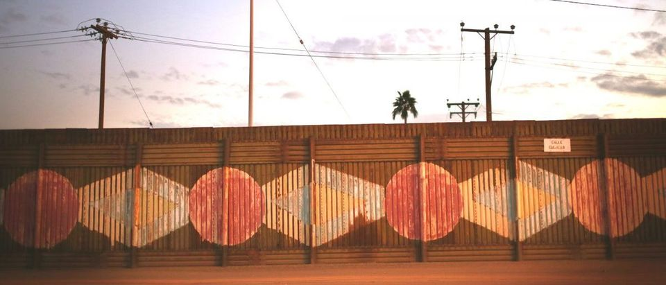 The U.S. - Mexico border wall stands on November 19, 2014 in Calexico, California. U.S. President Barack Obama plans to announce executive action on immigration reform Thursday Evening. (Sandy Huffaker/Getty Images)