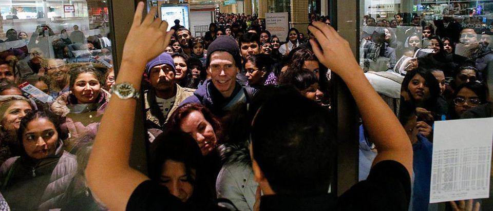 People wait in line to go shopping at the to JCPenney store at the Newport Mall on November 27, 2014 in Jersey City, New Jersey. (Photo by Kena Betancur/Getty Images)