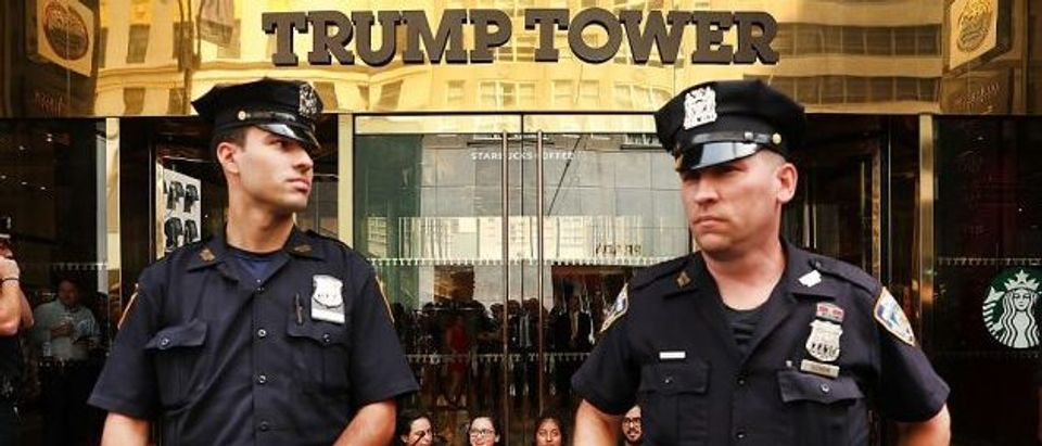 Protesters block the entrance to Trump Tower in Manhattan before being arrested on August 31, 2016 in New York City