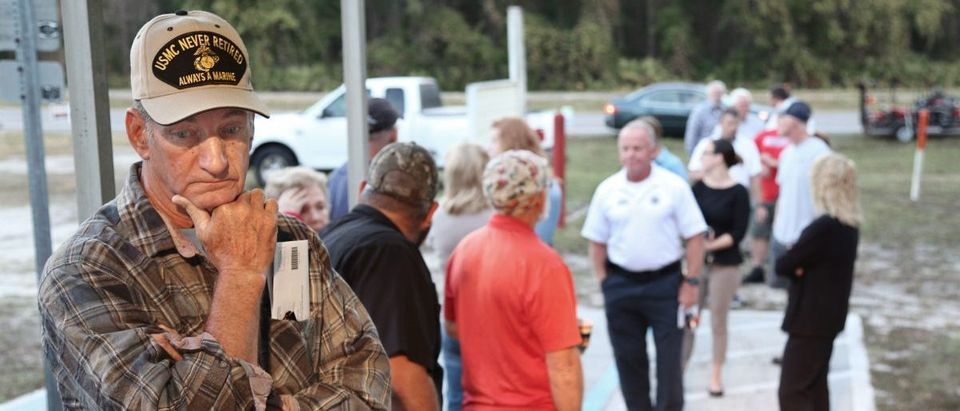 Voters line up outside a polling station in Christmas, Florida on November 8, 2016. After an exhausting, wild, bitter, and sometimes sordid campaign, Americans finally began voting Tuesday for a new president: either the billionaire populist Donald Trump or Hillary Clinton, seeking to become the first woman to win the White House. GREGG NEWTON/AFP/Getty Images