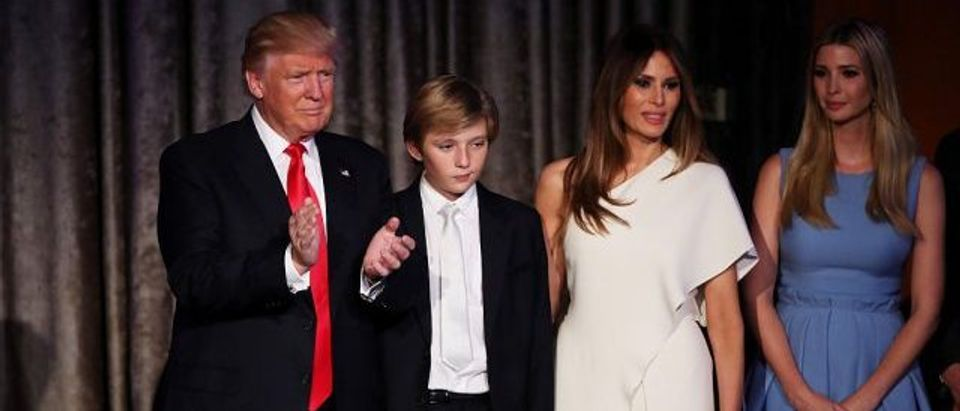(L-R) Republican president-elect Donald Trump, his son Barron Trump, wife Melania Trump, and daughter Ivanka Trump acknowledges the crowd along with his son Barron Trump during his election night event at the New York Hilton Midtown in the early morning hours of November 9, 2016 in New York City. Donald Trump defeated Democratic presidential nominee Hillary Clinton to become the 45th president of the United States